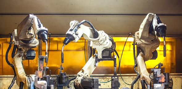 Robots two welding in factories industrial